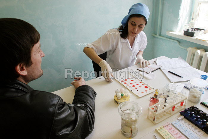 A nurse prepares for testing a patients blood at a newly set up central blood bank, Grozny, Chechnya, March 2005. - Boris Heger - 2005-03-21