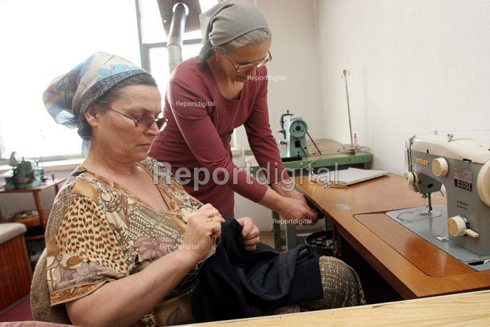 A group of unemployed woman founded a small cooperative making clothes in a building destroyed during the war, Grozny, Chechnya, March 2005. - Boris Heger - 2005-03-21