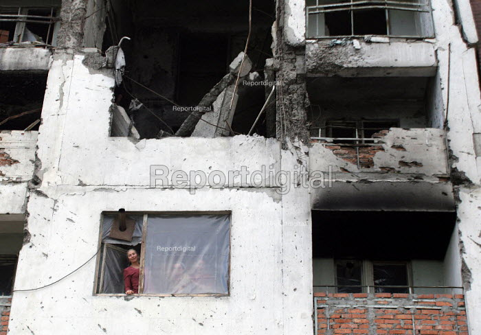 View of building destroyed during the war where a group of unemployed woman founded a small cooperative to make clothes, Grozny, Chechnya, March 2005. - Boris Heger - 2005-03-21