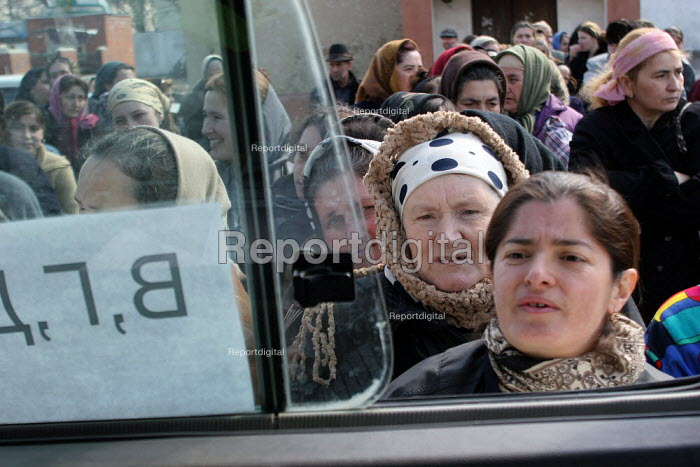 People queue up for obtaining new ID papers, Chali, Chechnya, March 2005. - Boris Heger - 2005-03-22