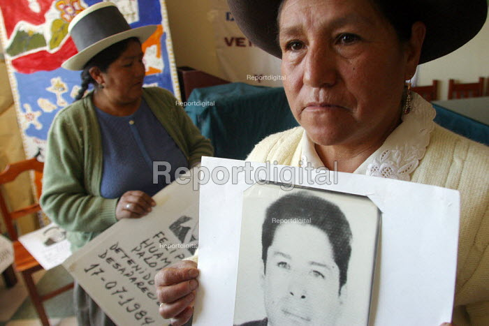 Ayacucho, Peru, September 2004 At the headquaters of the National Association of kidnapped and disappeared persons relatives ANFASEP. Missing's relatives display photographs of their loved ones and talk about them during an encounter. There are officially 2406 disappeared people only in Ayachucho, and around 7000 for the whole country from the time the famous leftist movement Sendero Luminoso was at war with the Government. - Boris Heger - 2004-08-29