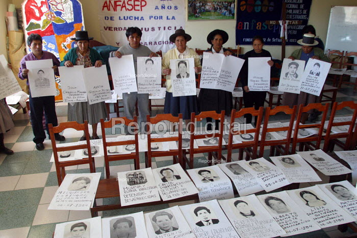Ayacucho, Peru, relatives display photographs of their disappeared loved ones. Officially 2406 people disappeared in Ayachucho, and around 7000 from the whole country when the famous leftist movement Sendero Luminoso was at war with the Government - Boris Heger - 2004-08-29