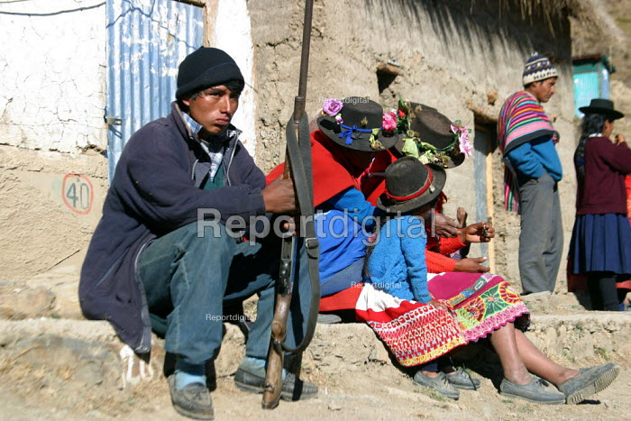 Self defence forces set up by local villagers meant to ensure order and protect from intruders, thieves and guellia groups in Toccasquesera, in the region of Ayacucho, Peru, September 2004. This area is difficult to access, with bandits roaming the mountains and attacking villages. - Boris Heger - 2004-08-29