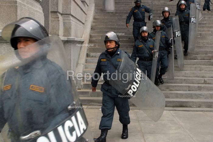 Anti riot policemen guard The Palace of Justice, Lima, Peru, September 2004. - Boris Heger - 2004-08-29
