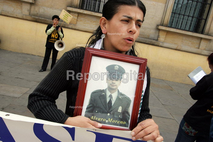 Miss Moreno, from the association ASFAMIPAZ (the organisation of relatives of the military and policemen held hostage by the FARC group) displays a picture of her husband kidnapped by the guerilla, in Plaza Bolivar, the main square of Bogota, Colombia, on Tuesday, February 20, 2007. The members of the association go to the place every week since more than 4 years, remembering their relatives and hoping to pressurize the government to negotiate rather than to attempt to free guerrilla hostages by force, as the President Uribe recently recalled.. - Boris Heger - 2007-02-20