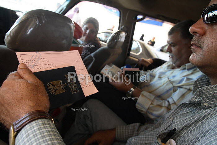 An Iraqi refugee holds his passport ahead of formality checks on the Syrian side of the border. Al Tanf Iraq-Syria border. - Morris Bernard - 2007-08-24