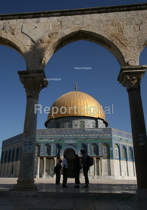 View of the Dome of the Rock, with shadowed passers by, near to the Al-Aqsa Mosque, East Jerusalem, September 2007. The sanctuary sheltering a stone believed to be the place from which the Prophet Muhammad ascended into heaven during his Night Journey to heaven, is the third most important sacred places to Muslims after Mecca and Medina. - Boris Heger - 2007-09-11