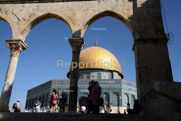 View of the Dome of the Rock with passers by, near to the Al-Aqsa Mosque, East Jerusalem, September 2007. The sanctuary sheltering a stone believed to be the place from which the Prophet Muhammad ascended into heaven during his Night Journey to heaven, is the third most important sacred places to Muslims after Mecca and Medina. - Boris Heger - 2007-09-11