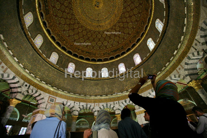 Interior view of the roof of the Dome of the Rock, near to the Al-Aqsa Mosque, with shadowed admirers, East Jerusalem, September 2007. The sanctuary sheltering a stone believed to be the place from which the Prophet Muhammad ascended into heaven during his Night Journey to heaven, is the third most important sacred places to Muslims after Mecca and Medina. - Boris Heger - 2007-09-11