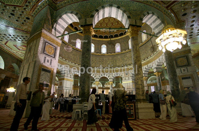 Interior view of the Dome of the Rock, near to the Al-Aqsa Mosque, East Jerusalem, September 2007. The sanctuary sheltering a stone believed to be the place from which the Prophet Muhammad ascended into heaven during his Night Journey to heaven, is the third most important sacred places to Muslims after Mecca and Medina. - Boris Heger - 2007-09-11