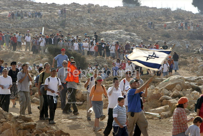 Jewish settlers march on the future site of the separation wall between in Israel and the West Bank, from the West Bank settlement of Efrat toward a hill called Eitam, near Bethleem, where they want to establish an outpost settlement. Israeli settlers and rightwing groups announced that they would attempt to create five new outpost settlements, not authorized by Israel. - Morris Bernard - 2007-09-30