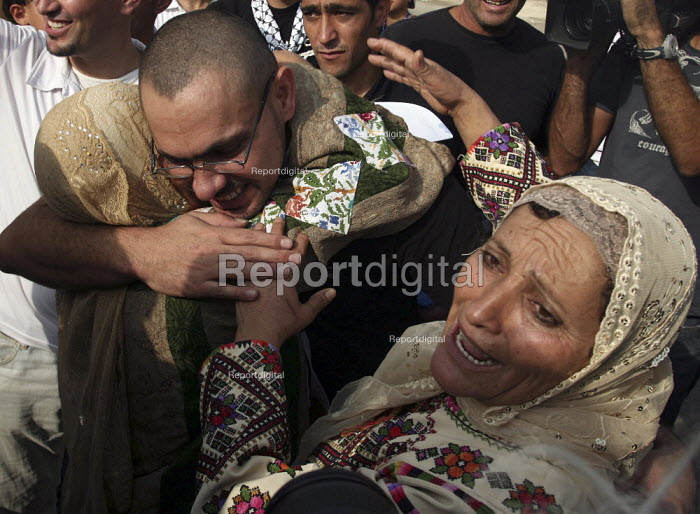 A former Palestinian prisoner, center, is greeted by his mother and sister, after being released from an Israeli jail. Fifty-seven Palestinian prisoners have been released and are welcomed back to Palestine as heroes. They have been let out of prison as a gesture of goodwill to president Mahmud Abbas. Palestinian President Mahmoud Abbas headquarters Ramallah, The West Bank. - Morris Bernard - 2007-10-01