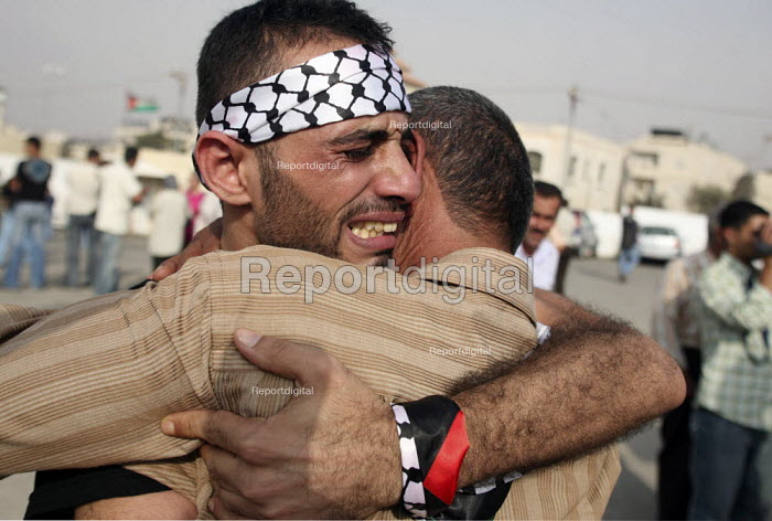 A former Palestinian prisoner, left, is greeted by his father, after being released from an Israeli jail. Fifty-seven Palestinian prisoners have been released and are welcomed back to Palestine as heroes. They have been let out of prison as a gesture of goodwill to president Mahmud Abbas. Palestinian President Mahmoud Abbas headquarters Ramallah, The West Bank. - Morris Bernard - 2007-10-01