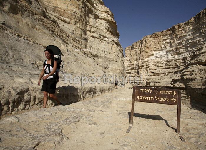 Foreign tourist walks the Zin river canyon, Ein Avdat National Park, Negev desert, Israel, October 2007. - Boris Heger - 2007-10-19