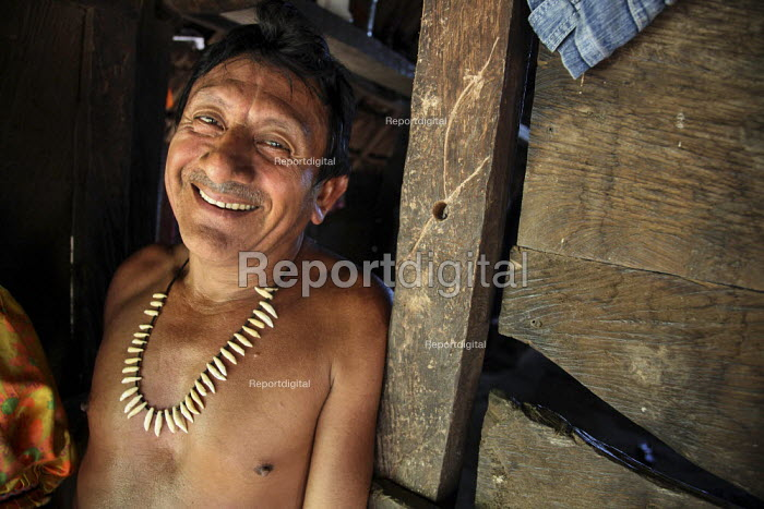 A Tule village chief, wearing a collar of monkey teeth he himself had hunted. This village of Indigenous Tule have been displaced by conflict, to the Panama border region of the Darien gap. Their culture is based on a strong relationship with the land and so losing it has diminished that culture. There are only a few thousands Tule left and their language is disappearing rapidly. Choco Department, Panama. - Boris Heger - 2010-05-06