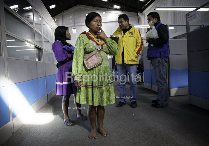 Internally displaced indigenous people being processed by the states help organisation in a poor and dangerous neighbourhood in Bogota. - Boris Heger - 2011-02-02