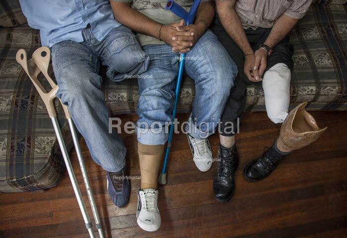 Internally displaced indigenous people who have stepped on landmines, sitting in the communal lounge of a charity, which takes care of them while they are on medical treatment in the capital, Bogota. - Boris Heger - 2011-02-03