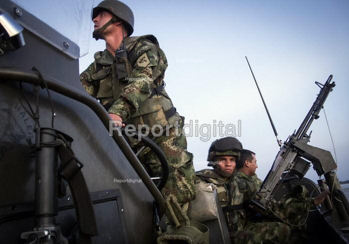 Colombian Navy Marine Corps soldiers, Third Riverine Marine Infantry Brigade, patrolling the river Putumayo. - Boris Heger - 2011-03-01