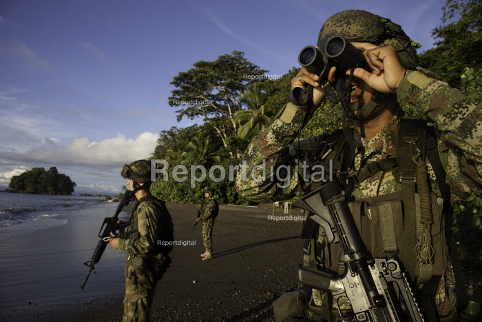 Colombian army soldiers anti narcotic patroling a beach and monitoring the movements of fast boats which could be smuggling cocaine. The pacific coast of Colombia is the main exit point for illegal export of cocaine out of the country. Choco, Colombia. - Boris Heger - 2011-08-18