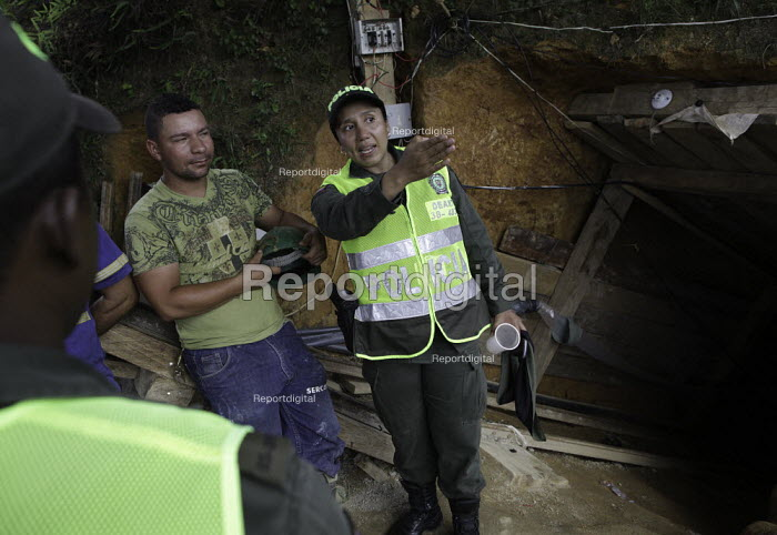 Police officers talk to distraught miners- has just lost everything as his illegal mine has been closed down by police officers. The Colombian government says it wants to control illegal mining and is giving licenses to big multinationals. Colombia is poised this year to pass from rank 16 to 7 in the worlds biggest gold exporters list and there is huge interest among foreign companies, as extractions cost are still relatively low. - Boris Heger - 2012-03-11
