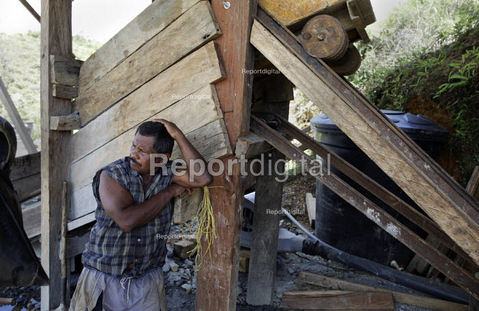A distraught miner cries as he has just lost everything as his illegal mine has been closed down by police officers. The Colombian government says it wants to control illegal mining and is giving licenses to big multinationals. Colombia is poised this year to pass from rank 16 to 7 in the worlds biggest gold exporters list and there is huge interest among foreign companies, as extractions cost are still relatively low. - Boris Heger - 2012-03-11