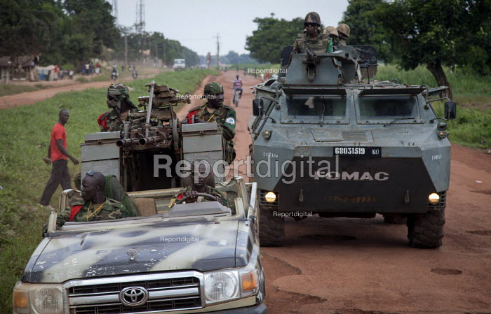 A column of the FOMAC (Multinational Force of Central Africa region) patrols the streets in an attempt to stabilize a volatile situation in Bangui, June 3, 2013, Central African Republic. Seleka former rebels took power in a bloody coup on March 24th. - Boris Heger - 2013-06-03
