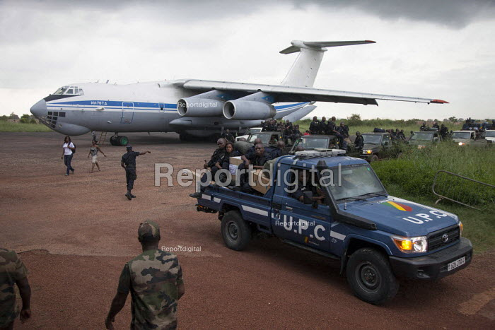 Congolese UPC reinforcements for the FOMAC disembark with their baggage on an airstrip June 4, 2013, in Bangui, Central African Republic. Seleka former rebels took power in a bloody coup on March 24th and are accused of widespread looting in the city. - Boris Heger - 2013-06-04