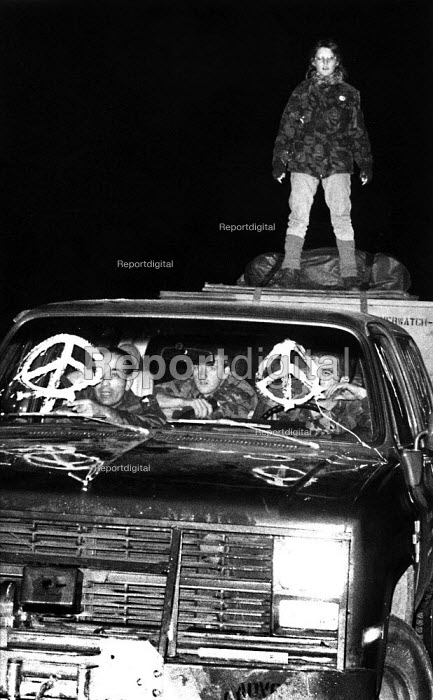 Sarah Graham on top of a Cruise Missile convoy vehicle stopped by Cruisewatch protest, Tilshead, Salisbury Plain 1986 - Bob Naylor - 1986-11-26