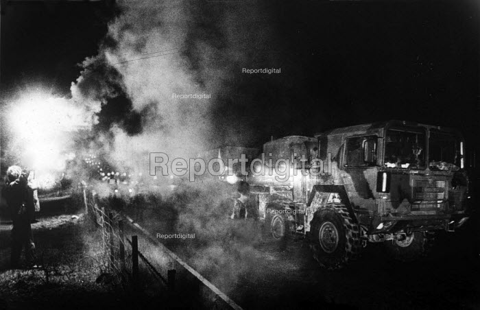 Cruisewatch protesters light up an American Cruise Missile convoy with flares as it returns to Greenham Common from Salisbury Plain. - Bob Naylor - 1986-12-04