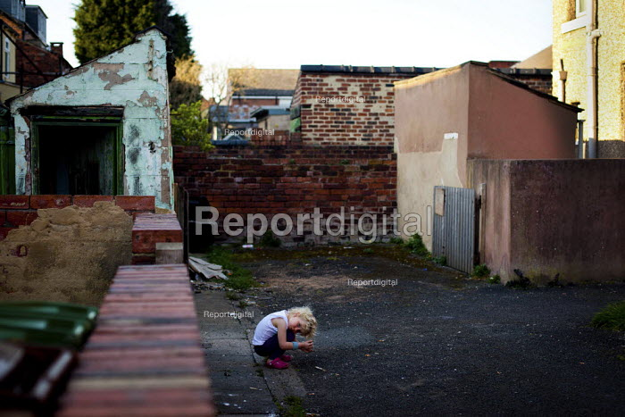A young girl plays outside at the back of her grandmother's house. The terrace houses were original built to house factory workers, very few have changed since being built and many are separated into bedsits. Bell Vue, Wakefield. - Connor Matheson - 2012-03-28