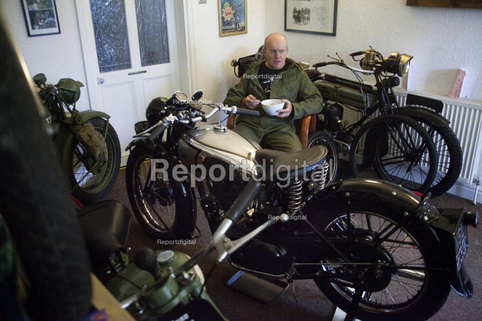 A motor bike enthusiast sits in his front living room eating his breakfast cereal. He lives in a normal small terrace house in Ryhill Wakefield but has no furniture in his front room because this is where he keeps his seven favourite motorbikes. He keeps his more modern bikes in a shed in the back garden. The bikes in his front room have been collected in over 40 years and have a combined value of almost �100,000. He says they are like his children and are his pride and joy. - Connor Matheson - 2012-04-07