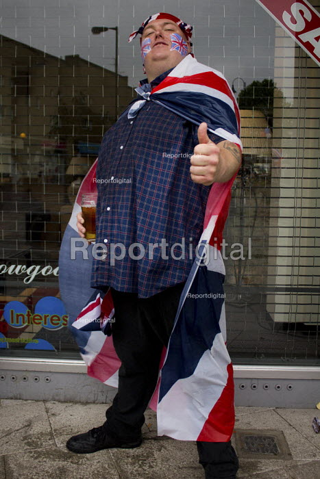A local man celebrates the Queen's Jubilee at a street party, with a thumbs up and a pint of lager, Bermondsey, London. - Connor Matheson - 2012-06-03