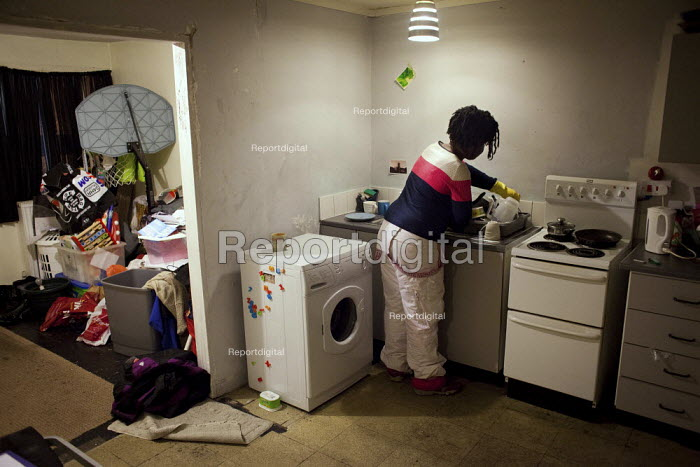 Doing the washing up. Olushola lives by her self at park hill flats and has done so on and off since she was 19. In April she was forced to move out in order to make way for the privatiseation and renovation of the estate. - Connor Matheson - 2012-12-19