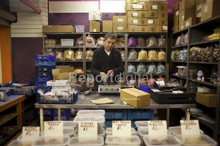 Weighing up sweets for the next day, Barnsley Market. Barnsley market is one of the most thriving sectors of the local economey and can feature up to 100,000 people per week. - Connor Matheson - 2013-01-08