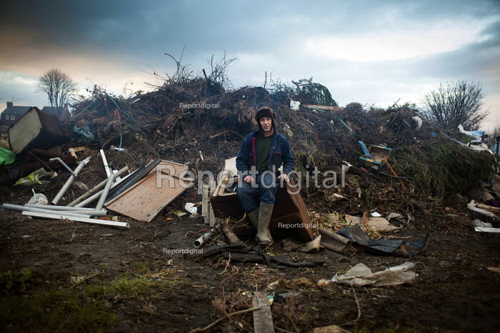 A Young man rests after working on his backyard farm and scrap yard, Ryhill wakefield. Yorkshire - Connor Matheson - 2013-12-10