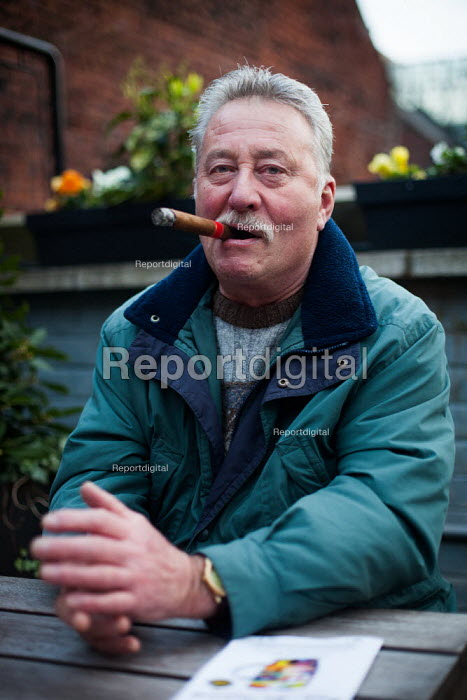 A man celebrates the weekend with a cigar in a Sheffield pub. - Connor Matheson - 2014-04-05