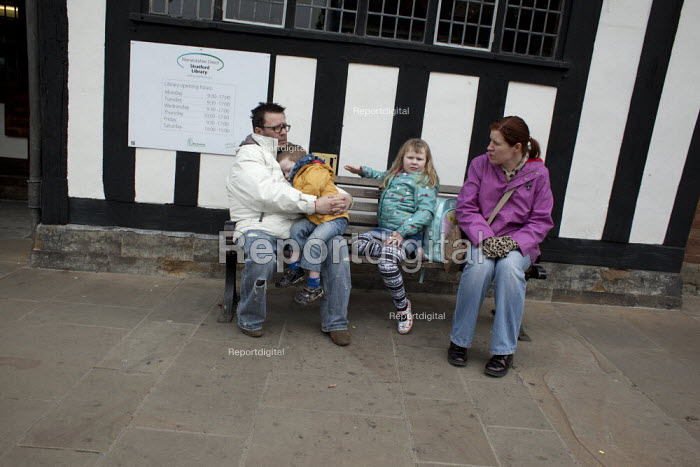 A family visiting Stratford-upon-Avon sitting outside the public library, Warwickshire - Connor Matheson - 2013-04-09