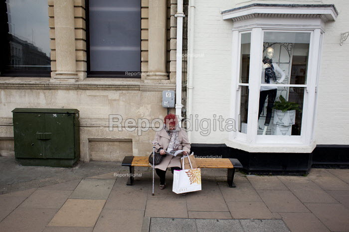 A woman visiting Stratford-upon-Avon sitting outside a clothes shop, Warwickshire - Connor Matheson - 2013-04-09