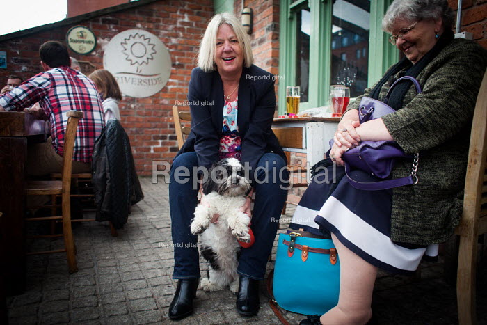 Maudy with her owner, The Riverside pub, Sheffield city centre. Paul kisses his dog Bella, Cudworth Barnsley. - Connor Matheson - 2014-05-03