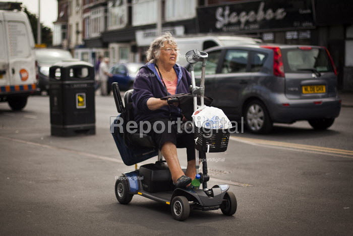 An elderly woman waiting to cross the road on her mobility scooter. Blackpool centre, Lancashire - Connor Matheson - 2014-07-21