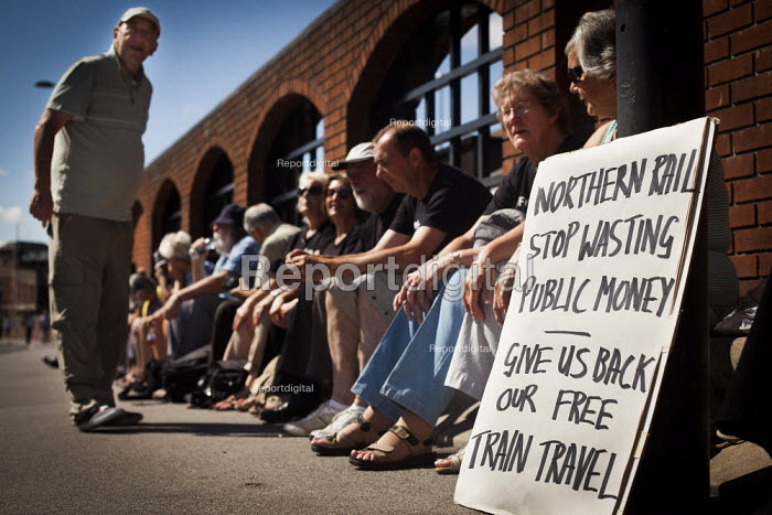 Freedom Riders gather outside Barnsley train station to demonstrate against cuts to free rail travel for pensioners. Barnsley, South Yorkshire. - Connor Matheson - 2014-07-28