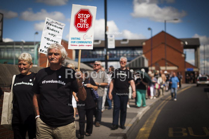 Freedom Riders march around Barnsley train station to demonstrate against cuts to free rail travel for pensioners. Barnsley, South Yorkshire. - Connor Matheson - 2014-07-28