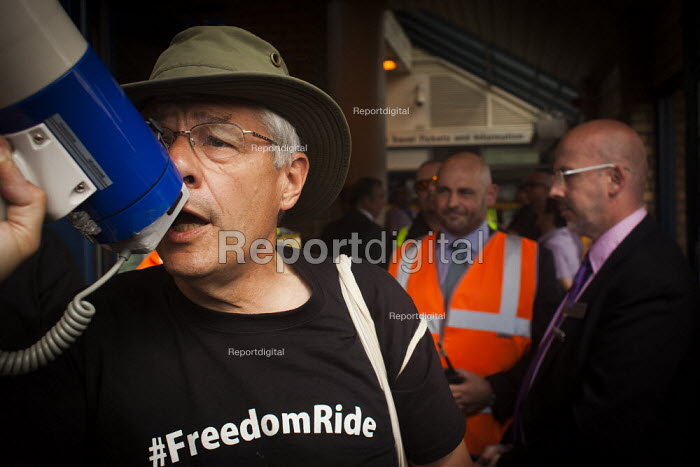 "George Arthur, who is a member of B.R.A.G and a ""Freedom Rider"" that was recently arrested at Sheffield train station for fare evasion, speaks to freeedom riders outside Barnsley train station. Barnsley, South Yorkshire. - Connor Matheson - 2014-07-28"