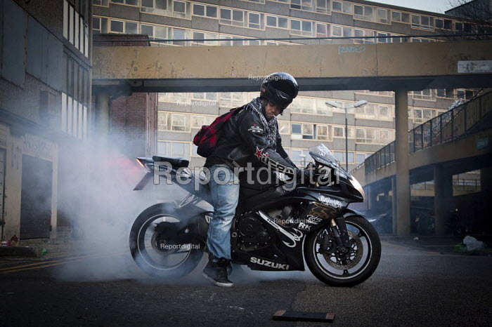 Burning rubber. Doing a wheel spin on a Suzuki GSX-R 600 motorcycle at the abandoned Heygate Estate. London - Connor Matheson - 2012-02-03