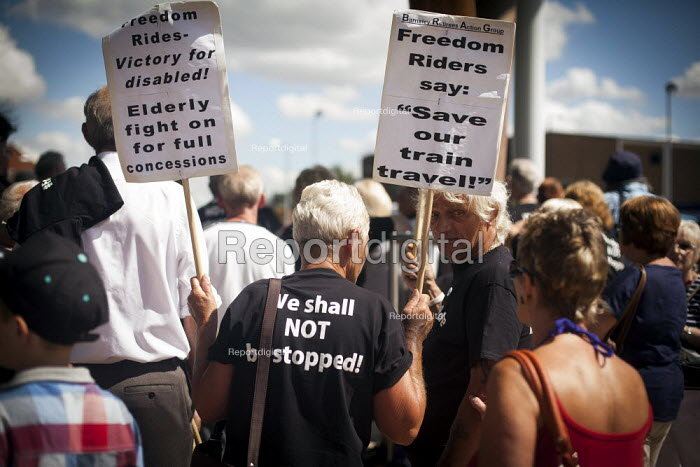 Freedom Riders rally outside Barnsley interchange to demonstrate against cuts to free rail travel for pensioners. Barnsley, South Yorkshire. - Connor Matheson - 2014-07-28