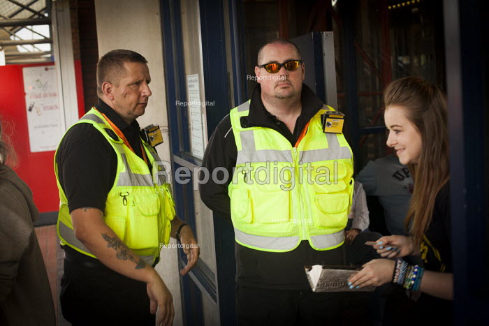 Revenue protection officers block the entrance to Barnsley train station in order to stop the freedom riders from boarding the train. Barnsley, South Yorkshire. - Connor Matheson - 2014-07-28