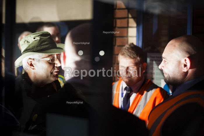 """George Arthur, who is a member of B.R.A.G and a """"Freedom Rider"""" that was recently arrested at Sheffield train station for fare evasion, attempts to negotiate with northern rail staff so the pensioners can stage their freedom ride. The staff refused any entry to people without valid tickets. Barnsley, South Yorkshire. - Connor Matheson - 2014-07-28"""