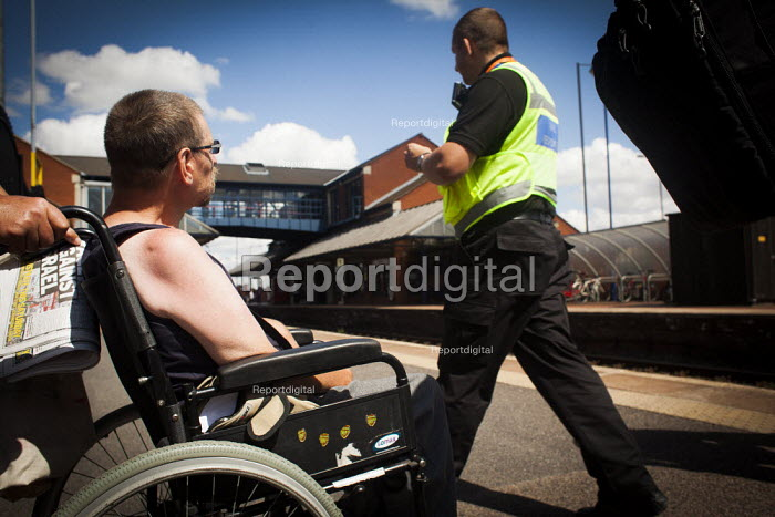 Disabled freedom riders with valid train passes gain access to Barnsley train station and wait for a train to Wakefield. Barnsley, South Yorkshire. - Connor Matheson - 2014-07-28