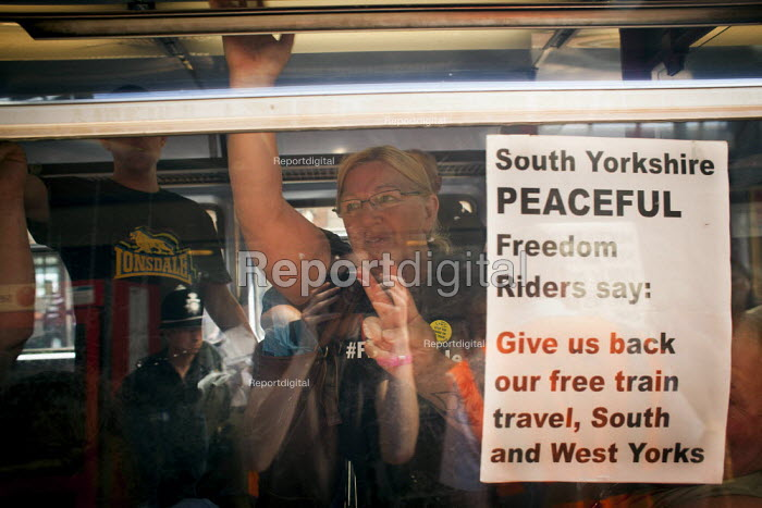 Disabled freedom riders with valid train passes board a train to Wakefield. Barnsley, South Yorkshire. - Connor Matheson - 2014-07-28