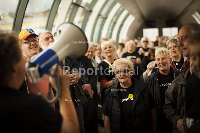 Dave Gibson makes a speech to Barnsley Freedom Riders rallying in protest for free rail travel for the elderly. Barnsley Interchange, South Yorkshire. - Connor Matheson - 2014-08-21